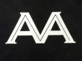 Initials for AAM, Personal embossed silver monogram on hard cover book.
