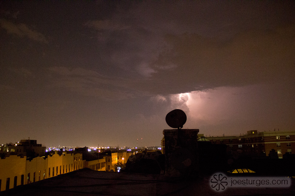 Purple lightning in Brooklyn New York from a rooftop.
