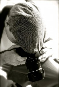 Photo of Joe Sturges holding a Canon digital camera in New York City - Photo by justberg.com